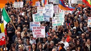 Paris protesters condemn descent towards genocide