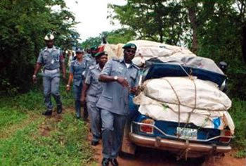 Customs impounds bullion van, 10 fairly used vehicles loaded with rice in Oyo