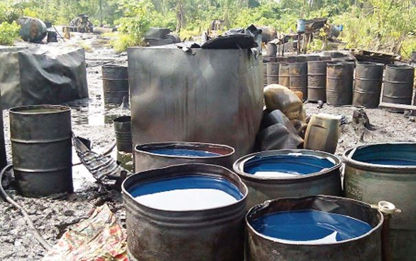 NAF destroys another set of illegal oil barges in Rivers
