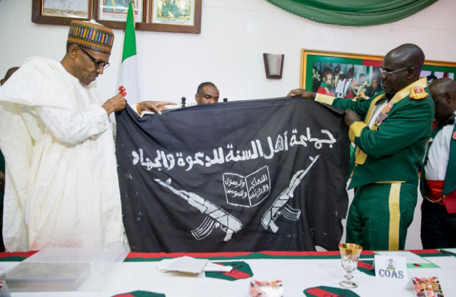 Army presents captured Boko Haram flag to Buhari