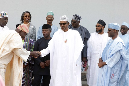 Buhari swears in six INEC electoral commissioners