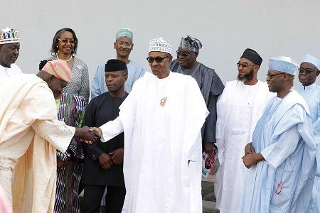 Buhari swears in six INEC electoral commissioners