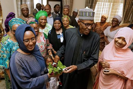 Aisha Buhari renews love for President, presents hubby with Gardenias flowers