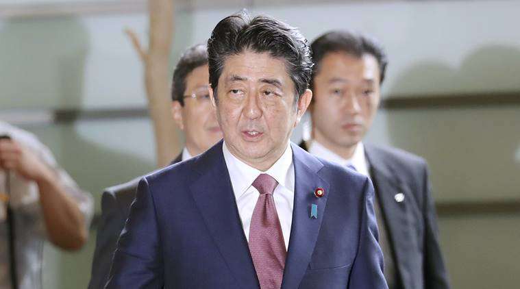 Japanese PM Shinzo Abe opts for safe hands over faces