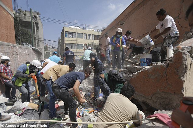 Mexico Earthquake: Rescue workers search for survivors at Primary School