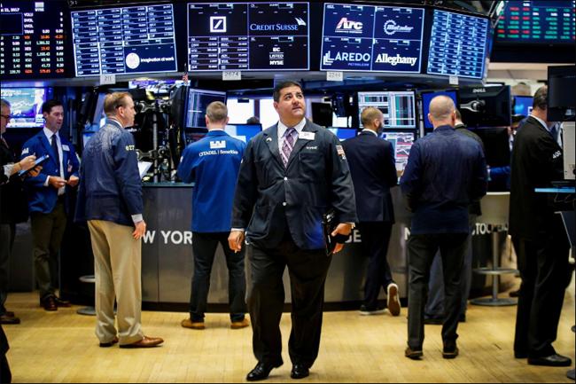 World stocks peak at start of Fed-fueled week
