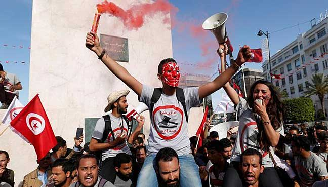 Tunisians march against contested corruption amnesty