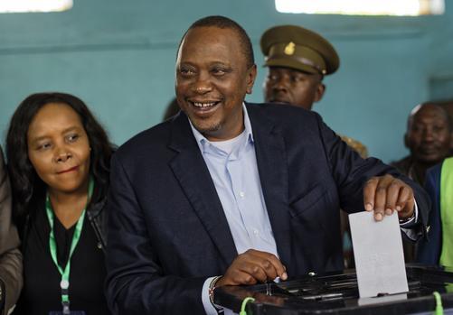 Kenyatta votes in Kenya's controversial presidential rerun