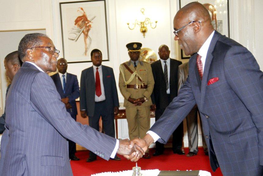 Mugabe swears-in Happyton Bonyongwe as Zimbabwe's justice minister