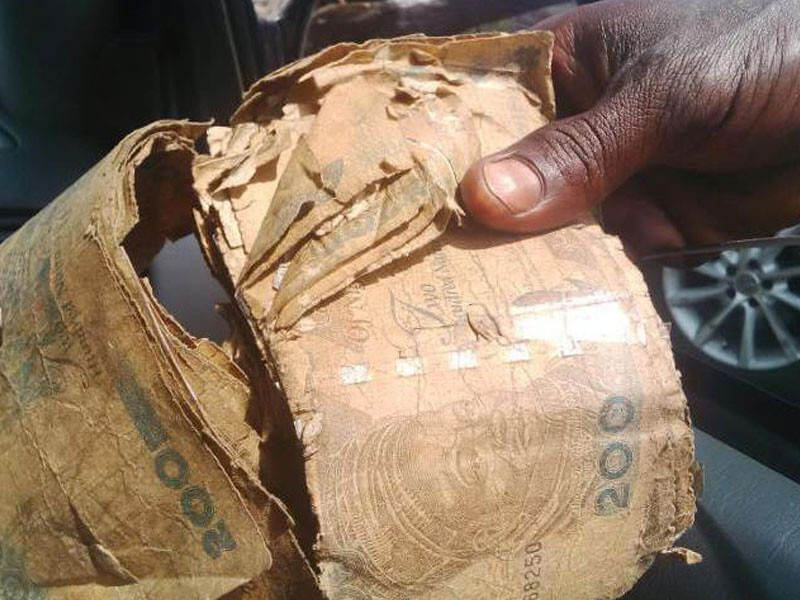 Reps urge CBN to remove surcharges on banks over mutilated naira notes
