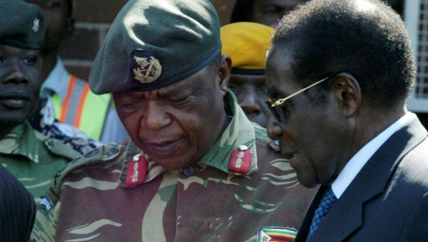 Armed forces seize power in Zimbabwe, but deny it's Coup