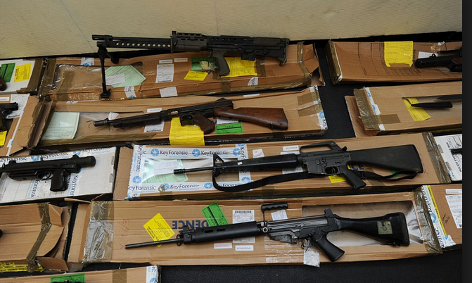 Taskforce displays seized cache of arms in Plateau