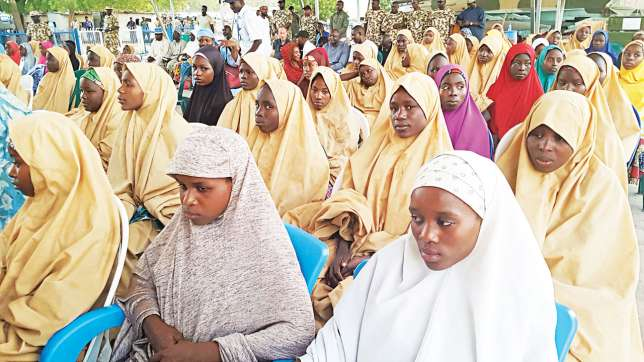 FG officially hands over released #DapchiGirls to their parents