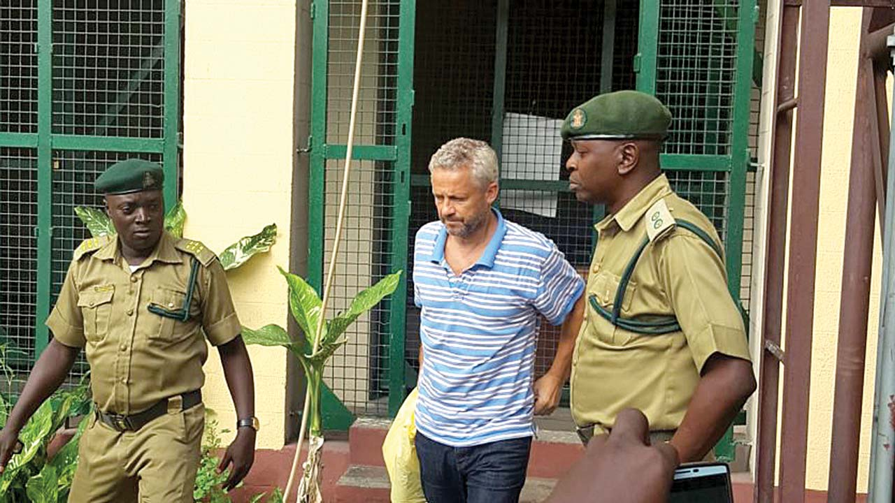 Danish man who murdered wife, daughter arraigned in court