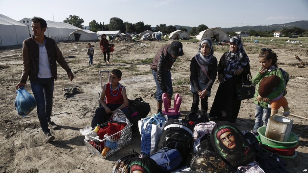 Refugees in Greece call for an end to conflict in Syria