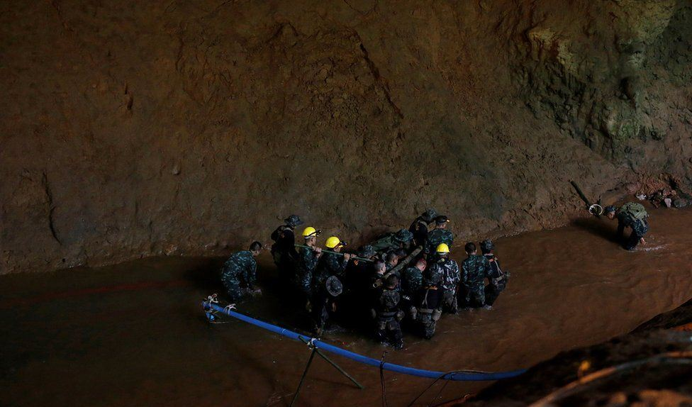 Thai cave: Trapped boys may be able to 'walk out' as water levels drop