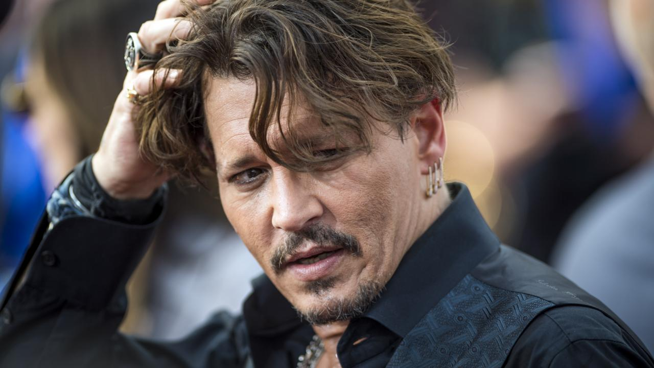 Johnny Depp charged for 'punching' crew member on Biggie Smalls film