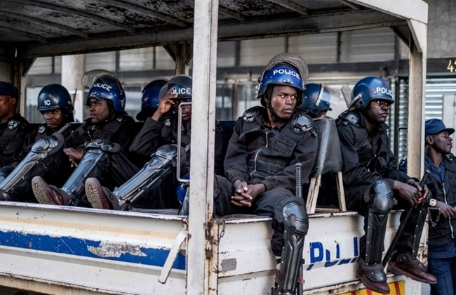 Zimbabwe police storm opposition MDC offices, detain 16 people