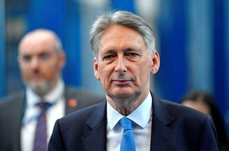 UK's Hammond says has money buffer in case of Brexit shock