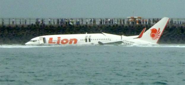 Indonesia plane crash: authorities recover bodies and debris