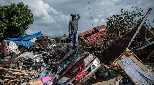 Death toll in Indonesia quakes jumps to 1,424
