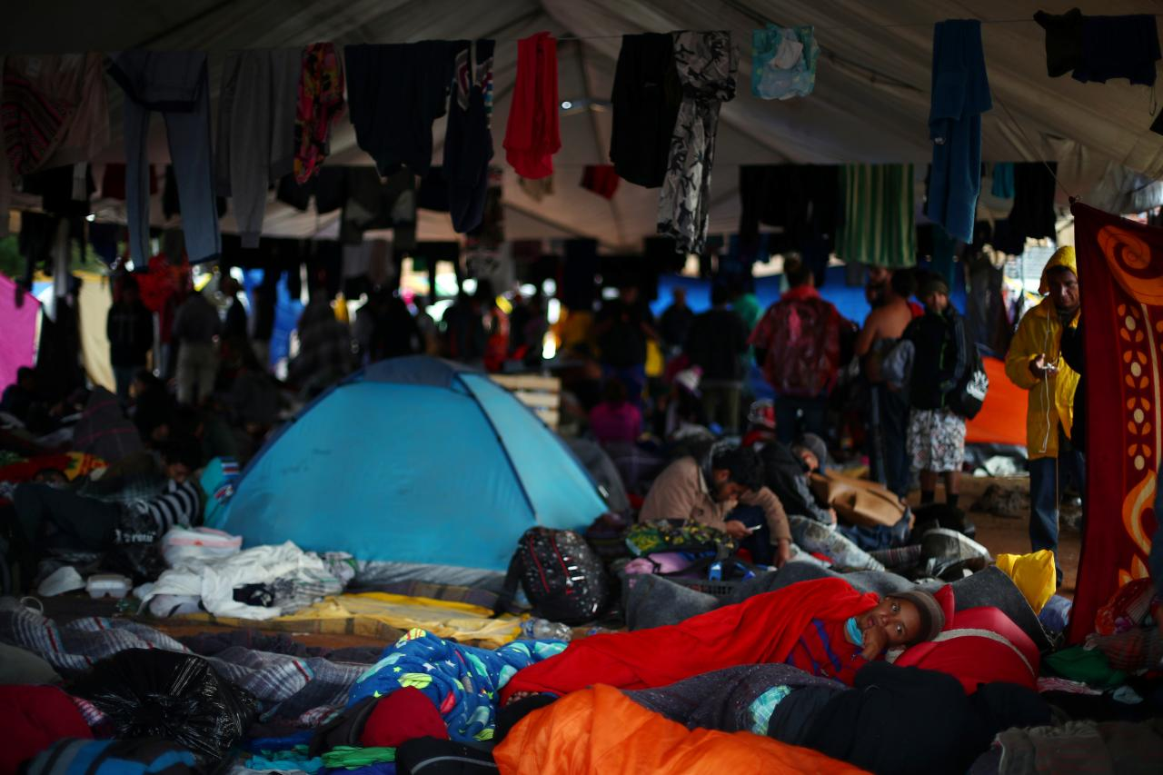 Migrants outside U.S.- Mexico border begin hunger strike as they await asylum