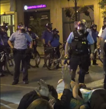 U.S police officers accused of beating undercover detective in street protest