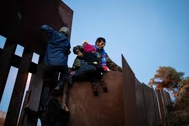 Mexican migrants try to climb border fence after tirelessly waiting for asylum